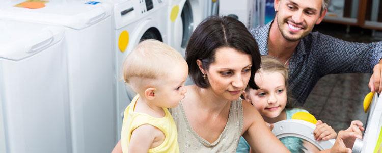 choosing washing machine in home appliance store